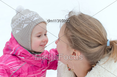 Mother And Daughter Outdoors In Winter Stock Photo