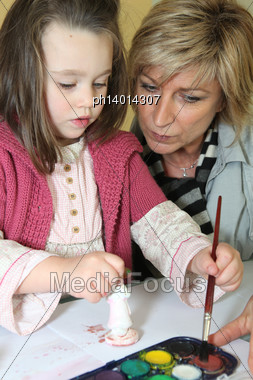 Mother And Daughter Painting Figurine Stock Photo