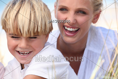 Mother And Son Having Fun Outdoors Stock Photo