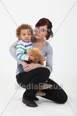 Mother And Son With Teddy Bear Stock Photo