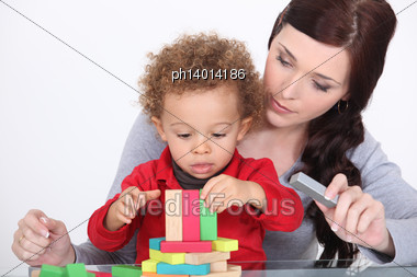 Mother Bonding With Son Stock Photo