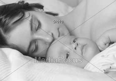 Mother Cuddling with Baby Stock Photo