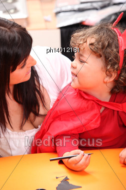 Mother And Cute Child Disguised As Devil Stock Photo