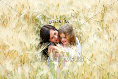 Mother And Daughter Are Happy And Laugh In The Rye Stock Photo