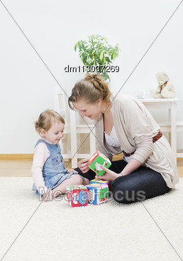 Mother And Daughter Playing In The Children's Cubes Stock Photo