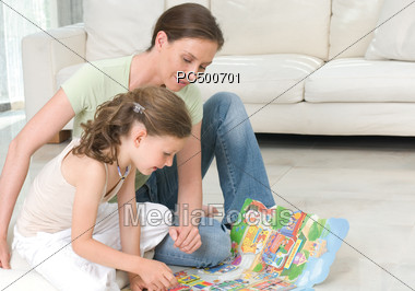 Mother & Daughter Reading Stock Photo