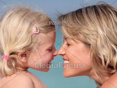 Mother & Daughter Rubbing Noses Stock Photo