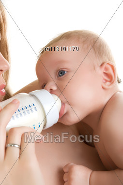 Mother Give Drink Her Baby Boy By Feeding Bottle Stock Photo