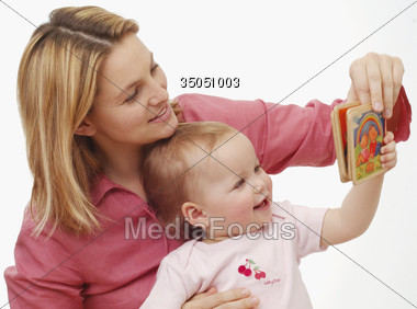 Mother Reading to Baby Stock Photo
