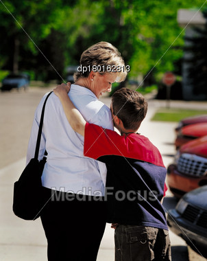 Mother And Son In Parking Lot With Son's Arm Around Mother's Shoulder Stock ...