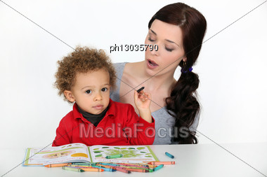 Mother Teaching Her Son Stock Photo