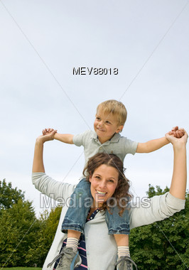 Mother with young son on her shoulders Stock Photo