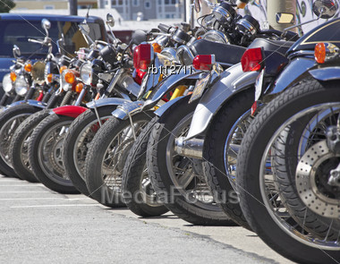 Motorcycles in a line parked on a street Stock Photo