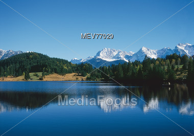 Mountainrange Reflected in Lake, Germany Stock Photo