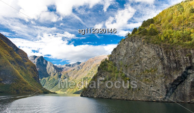 Mountains And Norwegian Fiord. Blue Sky With Clouds Stock Photo