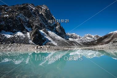Mountains And Sacred Lake Near Gokyo In Himalayas. Shot In Nepal Stock Photo