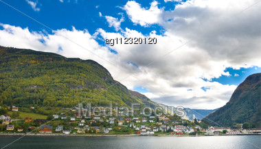 Mountains, Village And Norwegian Fiord. Blue Sky With Clouds Stock Photo