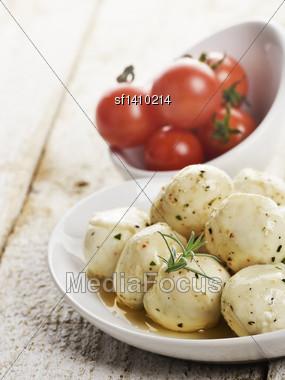 Mozzarella Cheese And Cherry Tomatoes In White Bowls Stock Photo