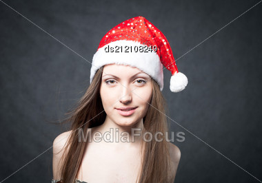 Mrs. Santa Dreaming About Chrismas Presents Isolated On Black Background Stock Photo