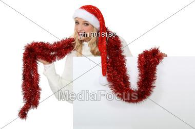 Mrs Santa Using A Tinsel As A Scarf. Stock Photo