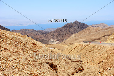 Multi-colored Mountains In The South Of Israel, The Descent To The Gulf Of Eilat Red Sea Stock Photo