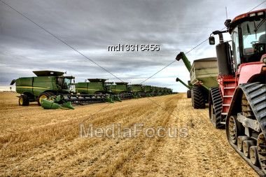 Multiple Combines In A Row In Saskatchewan Canada Stock Photo