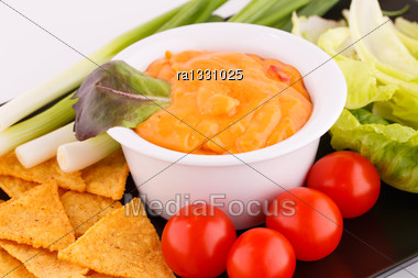 Nachos, Cheese Sauce, Vegetables Image Stock Photo