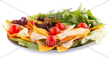 Nachos, Cherry Tomatos, Lettuce, Herbs In Plate On White Background Stock Photo