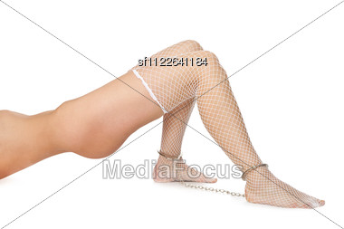 Naked Sexy Woman. Legs In Chains - Isolated. Stock Photo