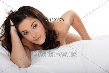Naked Woman Lying On Her Bed Stock Photo