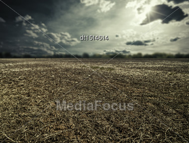 Natural Disaster. Abstract Landscape With Dry Land Under Mood Skies Stock Photo