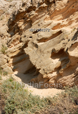Natural Texture - The Slope Of The Porous Stone Stock Photo