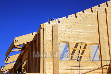 Natural Wood Construction Of A House Or A Trade For A Green Energy Isolation Stock Photo