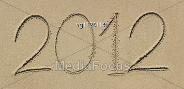 New 2012 Year Numbers Drawings In The Sand On The Beach Stock Photo