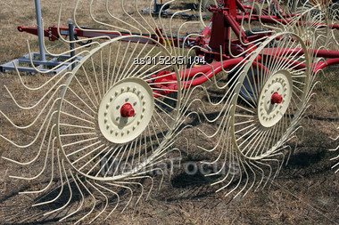 New Hay Raker Farm Equipment. Agricultural Machinery Stock Photo