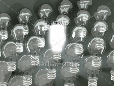 New Idea Or Invention: Illuminated Efficient Bulb Among Old Ones. Large Resolution Stock Photo