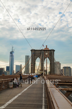 NEW YORK CITY - MAY 10: Brooklyn Bridge With Pedestrians On May 10, 2013 In New York City. It's A Bridge In New York City And Is One Of The Oldest Suspension Bridges In The United States. Completed In Stock Photo