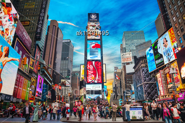 "NEW YORK CITY - MAY 11: Times Square With Tourists On May 11, 2013. Iconified As ""The Crossroads Of The World"" It's The Brightly Illuminated Hub Of The Broadway Theater District Stock Photo"