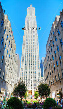 NEW YORK CITY - MAY 12: Rockefeller Center (GE Building) With People On May 12, 2013 In New York City. Rockefeller Center Is A Complex Of 19 Commercial Buildings Covering 22 Acres (89,000 M2) Between  Stock Photo