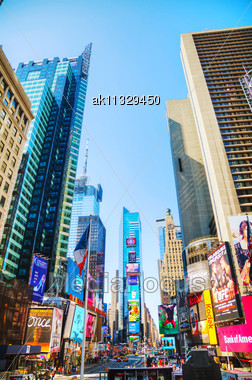 """NEW YORK CITY - MAY 12: Times Square With Tourists On May 12, 2013 In New York. Iconified As """"The Crossroads Of The World"""" It's The Brightly Illuminated Hub Of The Broadway Theater District, One Of Th Stock Photo"""