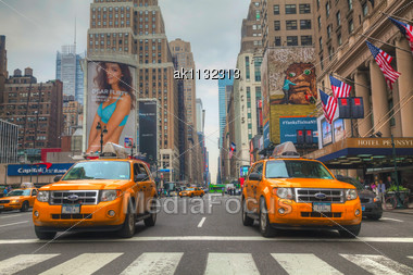 NEW YORK CITY - MAY 12: Yellow Taxis At The Street On May 12, 2013 In New York. Yellow Cars Serve As Taxis In NYC And Are Easy To Spot Among Other Vehicles Because Of Their Color Stock Photo