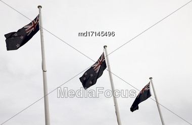 New Zealand Flag Blowing In The Wind Stock Photo