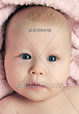 Newborn Baby Girl Lying On The Pink Blanket Stock Photo