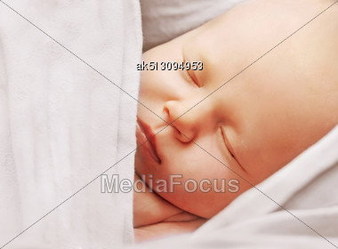 Newborn Sleeping In The Sling Stock Photo