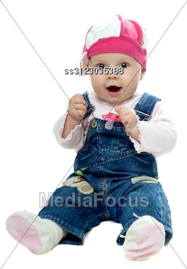 Nice Baby Girl In Jeans Suit Playing With A Dummy. Stock Photo