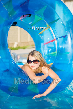 Nice Blond Woman Posing With Rubber Ring In Swimming Pool Stock Photo