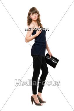 Nice Girl In Black Leggings With A Handbag. Stock Photo