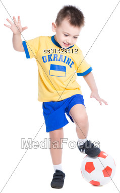 Nice Little Ukrainian Boy Playing In Football. Isolated On White Stock Photo