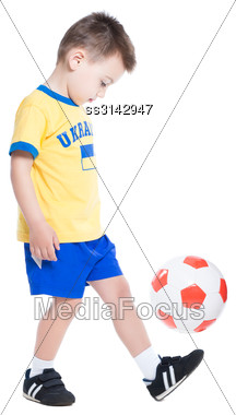 Nice Little Ukrainian Footballer Playing With A Ball. Isolated On White Stock Photo