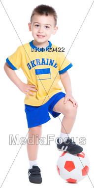 Nice Little Ukrainian Footballer Posing With A Ball. Isolated On White Stock Photo